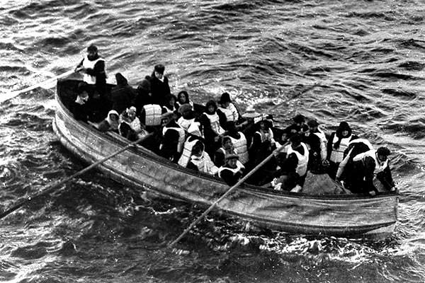 Titanic collapsible lifeboat D approaching the rescue ship Carpathia.