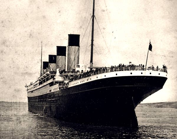 Titanic leaving Southampton at the beginning of her maiden voyage, with passengers gathered on deck