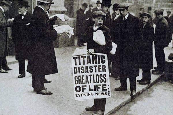 Newspaper seller Ned Parfett advertises that day's dramatic headline, 'Titanic Disaster Great Loss Of Life', outside the White Star Line offices in London, 16 April 1912.